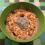 soy cherry yaourt topped with chia seeds and granola
